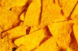 Heap of chips arranged on background