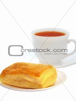 Appetizing puff with tea isolated on a white background