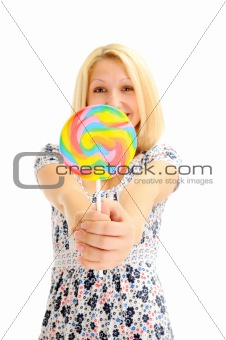 Attractive smiling blonde with lollipop