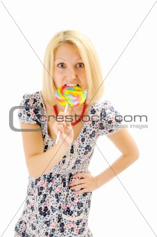 Attractive blonde eating lollipop