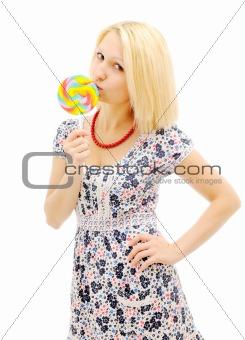 Attractive blonde eating lollipop