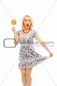 Attractive surprised  blonde with lollipop