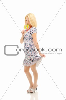Attractive blonde with lollipop holding her dress