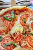 Margaritta pizza with tomatoes and basil cheese