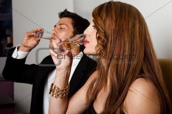 Couple drinking liquor shots