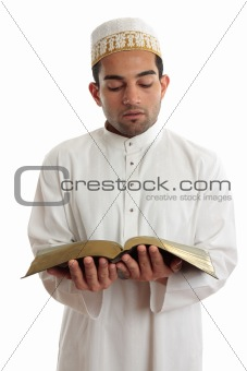 Man reading a religious or other book