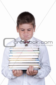 Boy holds heavy books