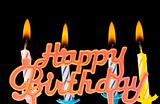 """Multi coloured candles with """"Birthday"""" isolated on black"""
