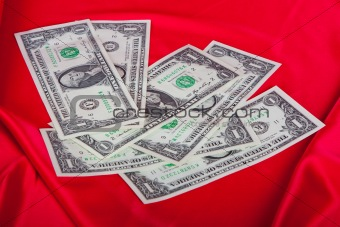 One dollar bills on red background