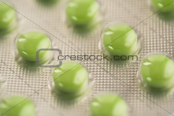 Close up of green pills