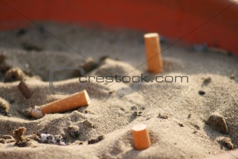 ashtray in sand