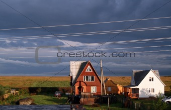Country cottage at a dawn with a line of external wires