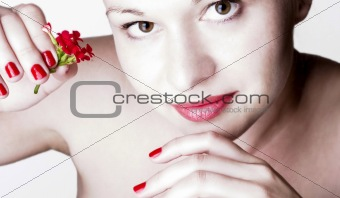 Beautiful woman with red flowers.