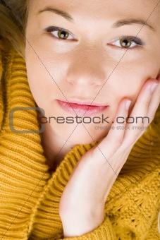 Beautiful young woman wearing yellow cardigan.