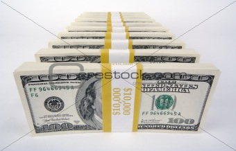 Stacks of One Hundred Dollar Bills on a white background