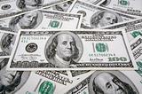 One Hundred Dollar Bills laying flat.