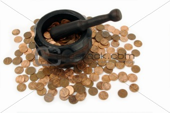 Grinding for Pennies - Wood mortar and pestle containing pennies bills on a white background.