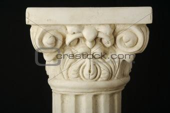 Ancient Column Pillar Replica on a Black Background.