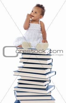 baby on a book tower