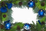 Christmas frame with blue balls and bells isolated on white