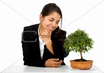 business girl with a tree on her desk