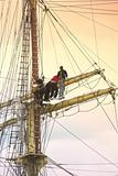 Sailors on old sailing ship
