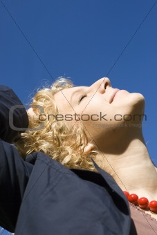 Smiling women looks upwards