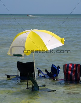 Sinking umbrella and chairs