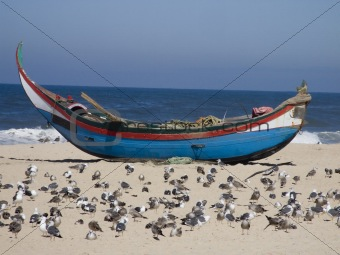 Fisherman boat on the sand