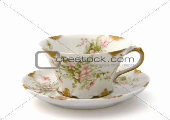 Antique Teacup and Saucer on White
