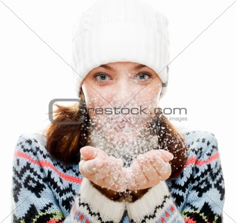 Beautiful woman blowing snow 