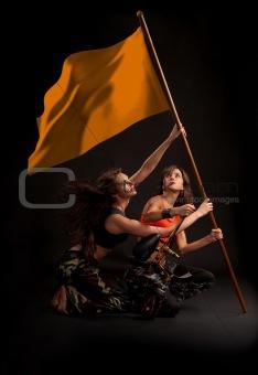 Paintball girl rising victory flag