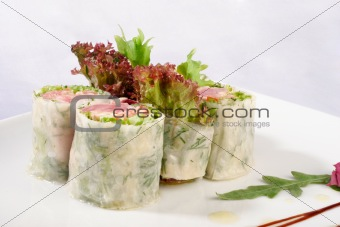 Image of sushi decorated with lettuce