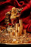 Laughing Budda with golden coins