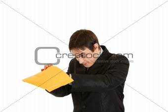 Interested young businessman checking parcel