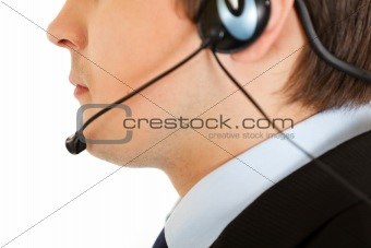 Thoughtful modern businessman with headset. Close-up.