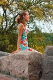 Young girl relaxing on the stone