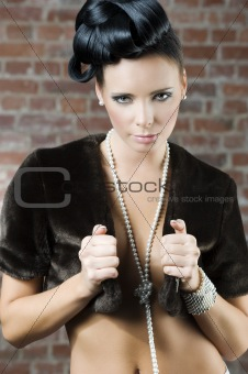 girl with fur and jewellery