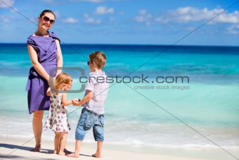 Mother with kids on tropical beach
