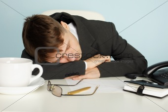 Office worker was tired and fell asleep at table