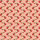 Seamless pattern with apples on the green background