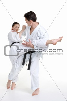 Karate. Young girl and a men in a kimono with a white background