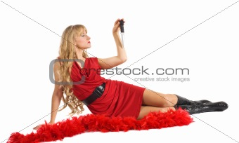 Beauty woman in red play with blade
