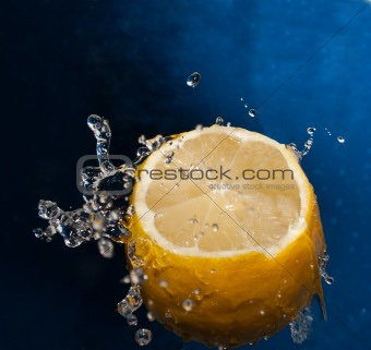 Water splash on a lemon