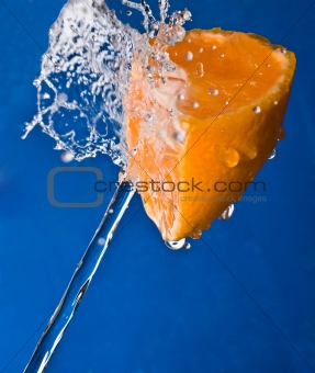 Water splash on a orange
