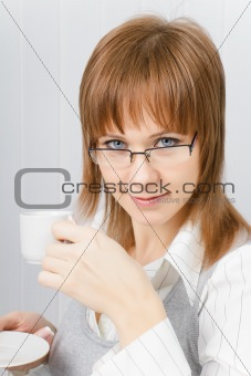 attractive girl in the office with a cup of coffee