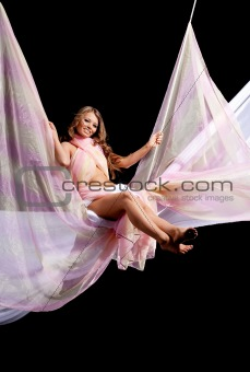Girl on swing with color textile