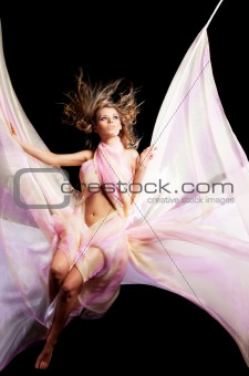 Beauty girl on swing with color textile