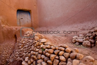 A pink narrow street in a village of Africa