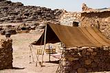 A berber tent in Moroco in Africa with a kettle.